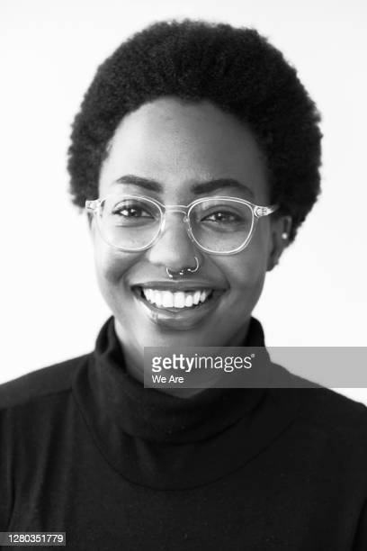 smiling woman with glasses - confidence stock pictures, royalty-free photos & images