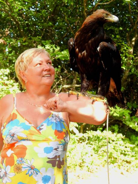 Smiling Woman With Golden Eagle On Arm