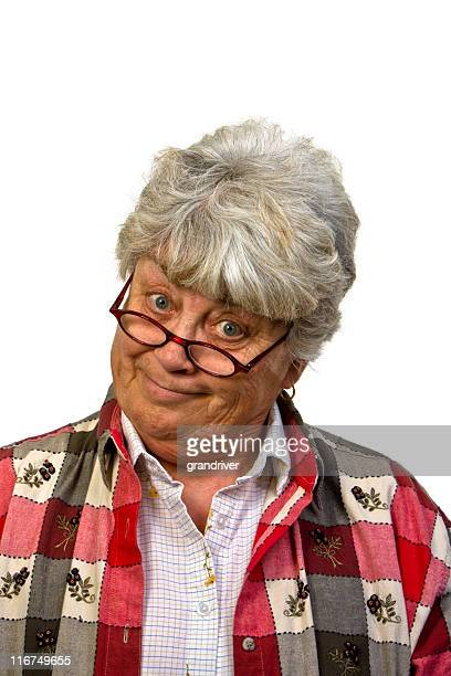 smiling woman with head cocked - mother in law stock pictures, royalty-free photos & images