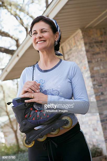 Smiling woman with inline skate