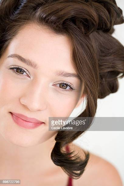 Smiling woman with lock of hair over face