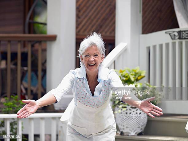 smiling woman with open arms - arms outstretched stock pictures, royalty-free photos & images