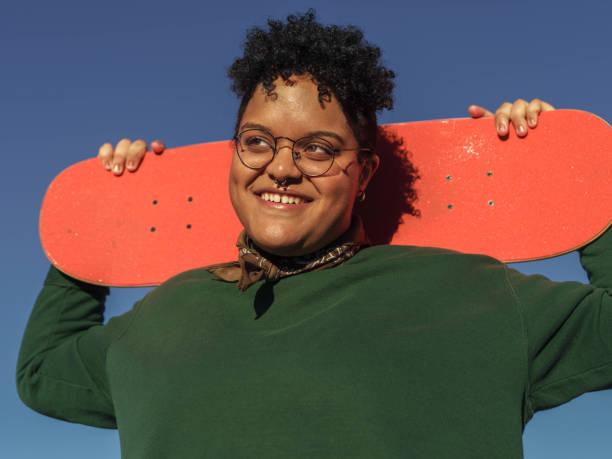 Smiling Woman with Orange Skateboard