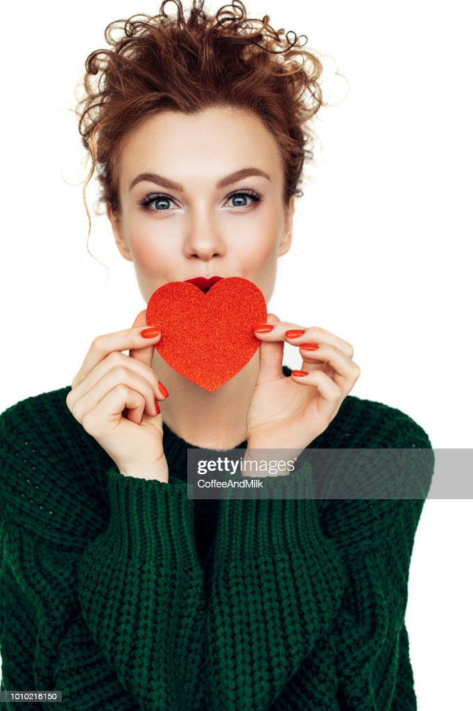 Smiling woman with paper heart : Stock Photo