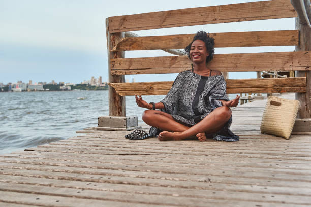 Smiling woman with sitting on a wooden footbridge