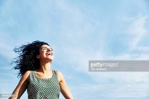 Smiling woman with sky