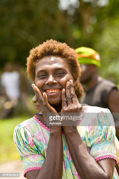 Smiling woman with teeth stained from chewing betel nut Noipuas New Hanover Island New Ireland Province Papua New Guinea