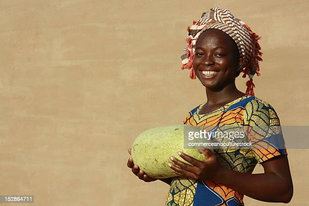 Smiling woman with watermelon
