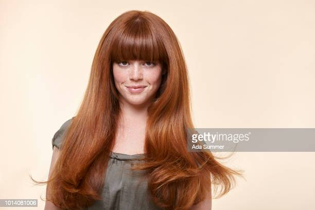 smiling woman with windblown red long hair - fringing stock pictures, royalty-free photos & images