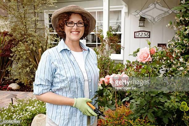 Smiling woman working in garden