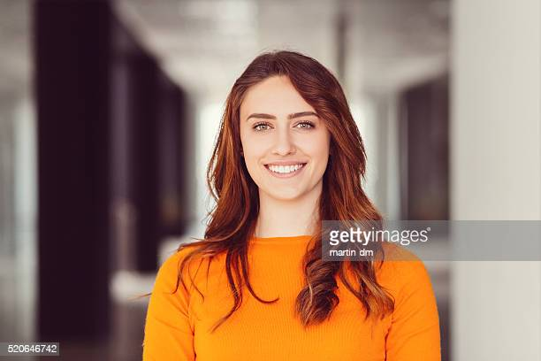 smiling woman's portrait - redhead girl stock photos and pictures
