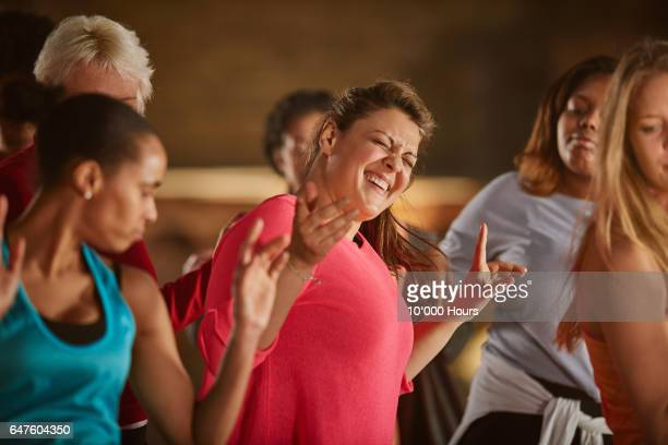smiling women dancing in gym. - mature women stock pictures, royalty-free photos & images