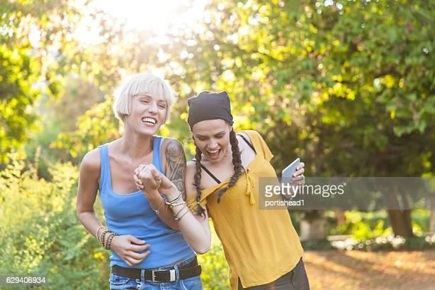 Smiling women having fun in park