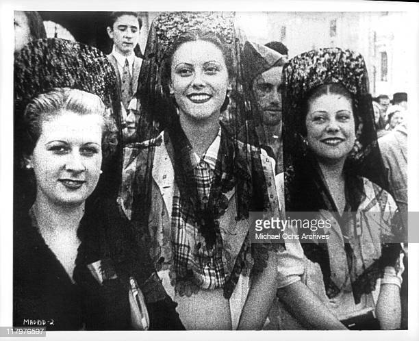 Smiling women in a scene from the film 'To Die in Madrid' aka 'Mourir a Madrid' 1965