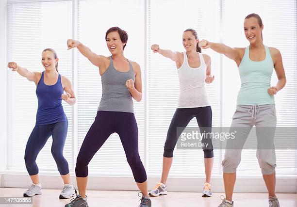 Smiling women in exercise class