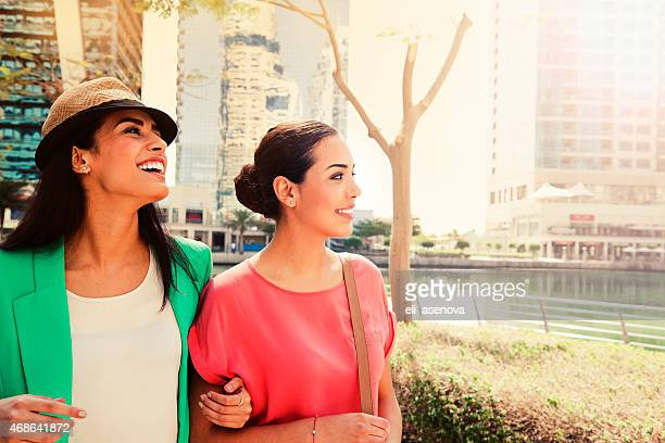 Smiling women outside of the Jumeirah Lake Towers in Dubai