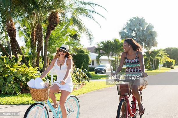 smiling women riding bicycles - delray beach stock pictures, royalty-free photos & images