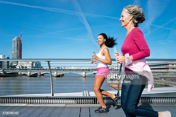 Smiling Women Running Together