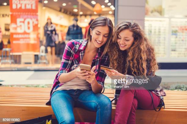 Smiling women shopping online with credit card