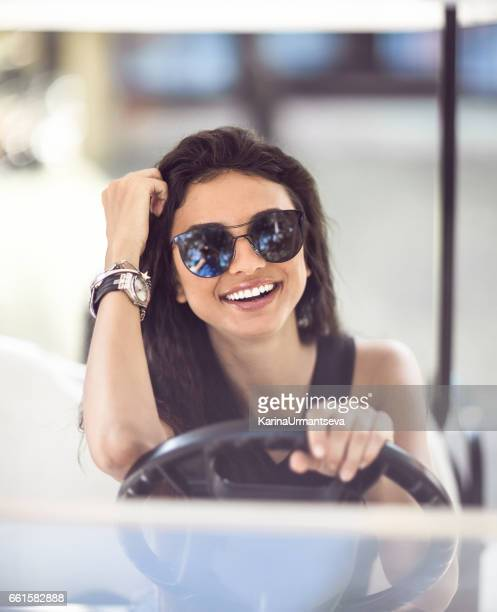 Smiling women sitting in the golf car