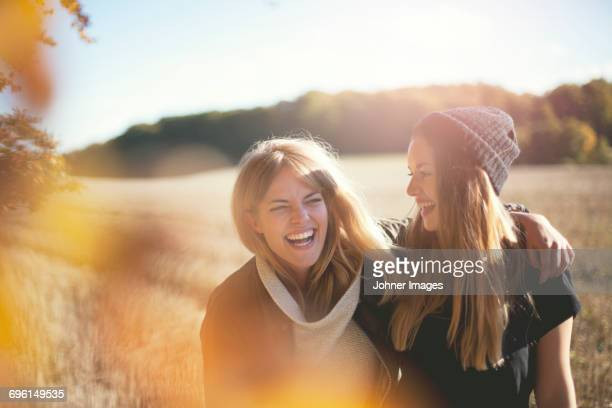 smiling women together - female friendship stock pictures, royalty-free photos & images
