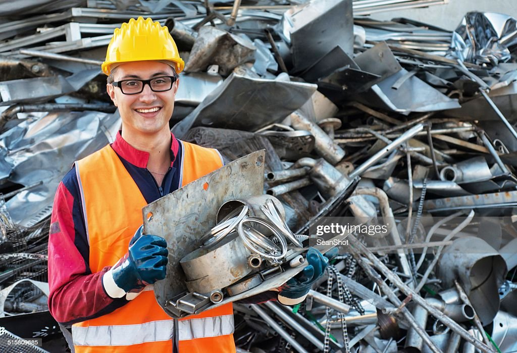 Smiling Worker in Metal Landfill : Stock Photo