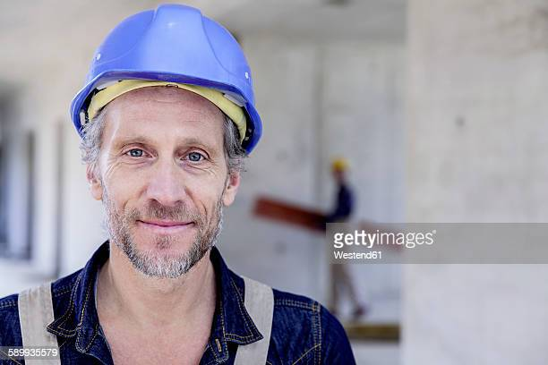 Smiling worker on construction site