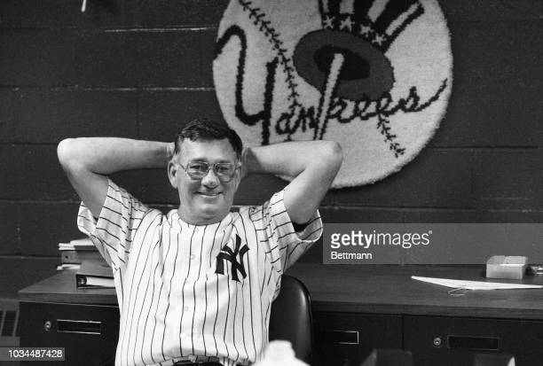 Smiling, Yankees manager, Bob Lemon, leans back in a chair while talking to reporters at Yankee Stadium after the Yanks beat Cleveland, 3-1. It was...