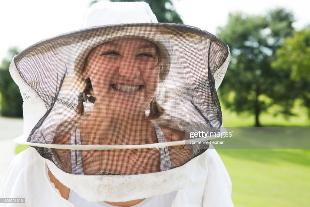 Smiling Young Bee Keeper at Honey Harvest : Stock Photo