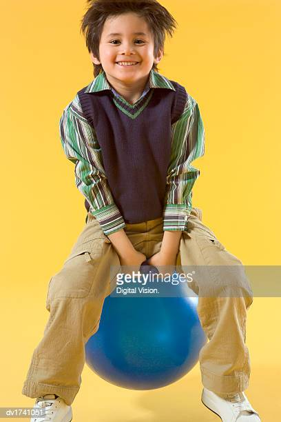 Smiling Young Boy Bouncing on a Space Hopper