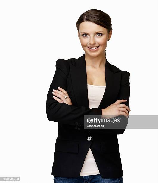 Smiling young business female with arms crossed against white