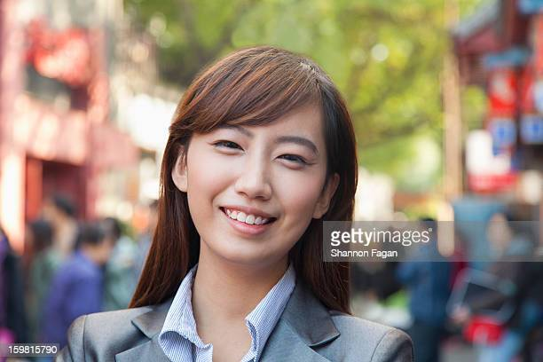 Smiling Young Business Woman in Nanluoguxiang