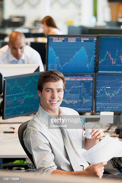 Smiling young businessman having coffee