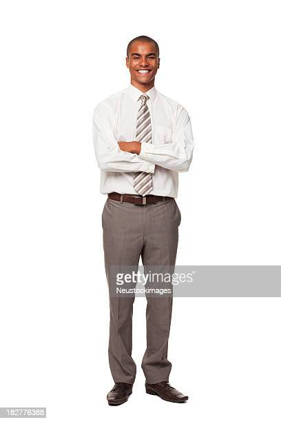 smiling young businessman. isolated. - black trousers stock pictures, royalty-free photos & images