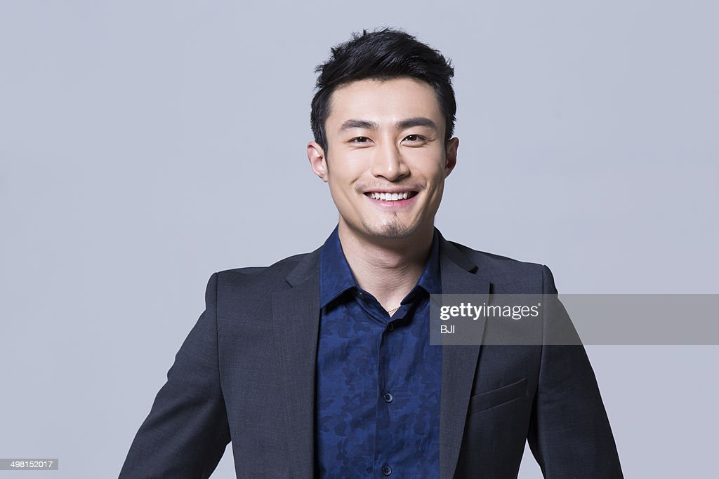 Smiling young businessman : Stock Photo