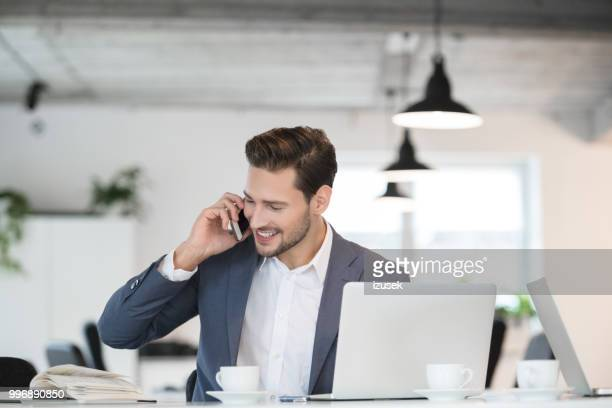 Smiling young businessman working in office