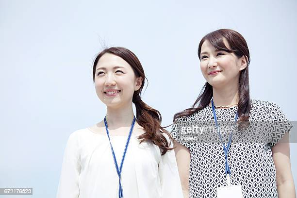 Smiling young businesswomen looking at view