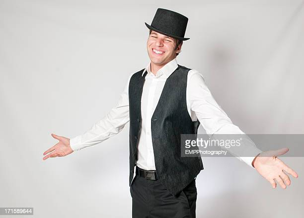 Smiling Young Caucasian Man with Arms Open in Top Hat