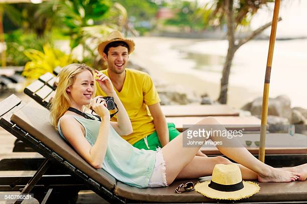 Smiling young couple at beach