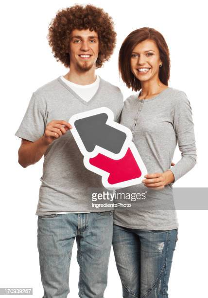 Smiling young couple holding data trade sign isolated on white