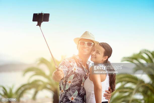 Smiling Young Couple how Taking Selfie on Summer Beach