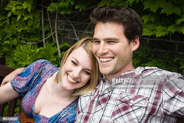 """a smiling, young couple leaning on each other - """"compassionate eye"""" stock pictures, royalty-free photos & images"""