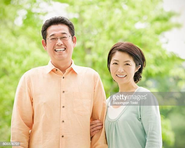 smiling young couple - 中年カップル ストックフォトと画像
