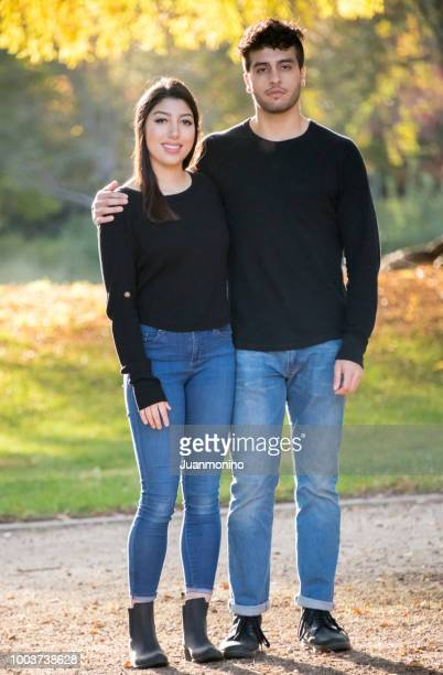 smiling young couple posing together - israeli ethnicity stock pictures, royalty-free photos & images