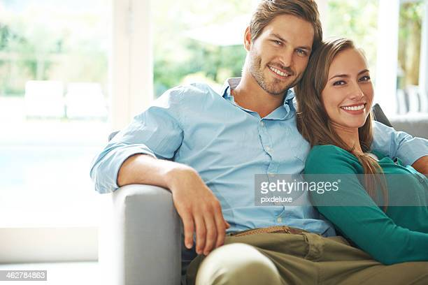 Smiling young couple relaxing on couch