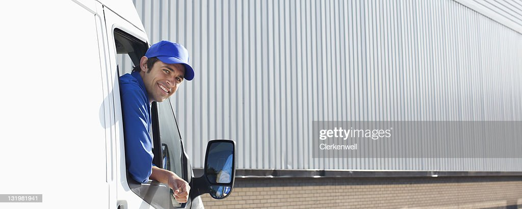 Smiling Young Delivery Van Driver Peeking Out Of Window Stock Photo ...