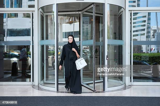 Smiling, Young Emirati Woman in Abaya Leaving Modern Luxury Hotel