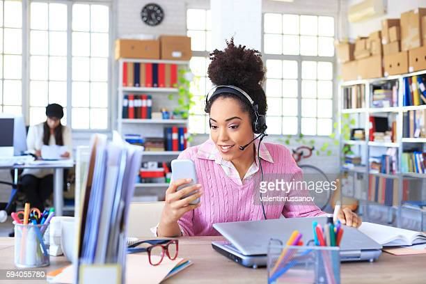 Smiling young female assistant working