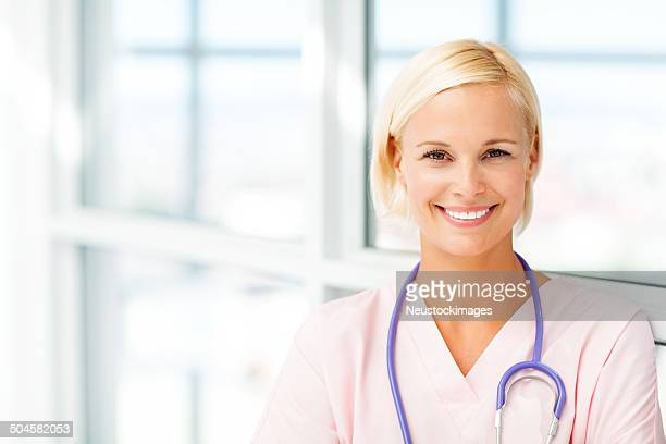 Smiling Young Female Nurse In Hospital