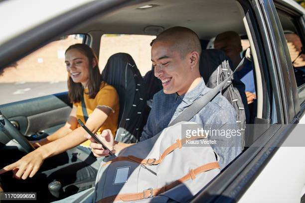 smiling young friends enjoying in car on sunny day - part of a series stockfoto's en -beelden